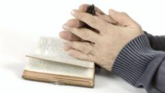Bible pray hands white Stock Footage
