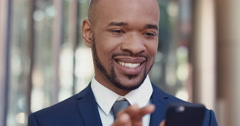 Portrait of African American Businessman outside corporate office building Stock Footage