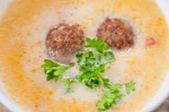Cheese soup with meat balls - stock photo