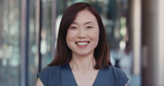 Portrait of Japanese Businesswoman outside corporate office building Stock Footage