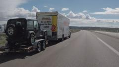Driver Viewpoint U-haul Moving Truck Towing Car Passing Stock Footage