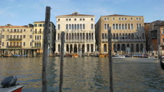 Boat and gondola passing by the City Hall of Venice Stock Footage