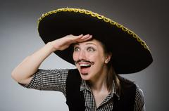 Person wearing sombrero hat in funny concept Stock Photos