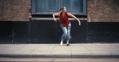 Contemporary funky caucasian woman street dancer dancing freestyle in the city - stock footage