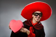 Stock Photo of Person wearing sombrero hat in funny concept