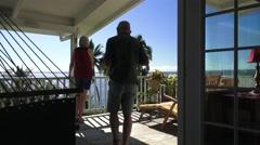 Man bring wife coffee on lanai  Hawaii Stock Footage