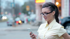 Beautiful business lady on the phone solves business cases - stock footage
