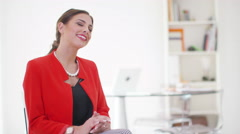 4K Portrait of attractive smiling businesswoman alone in office Stock Footage