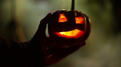 Holding miniture pumpkin halloween  2 fog foggy Stock Footage