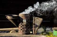 Antique bee smoker - stock photo