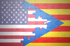 Stock Photo of puzzle with the national flag of united states of america and catalonia