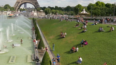Tourists at Fountain of Warsaw, on a sunny day in Paris Stock Footage