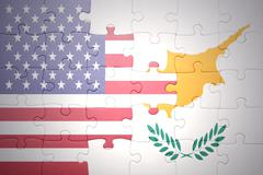 Stock Photo of puzzle with the national flag of united states of america and cyprus
