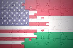 Stock Photo of puzzle with the national flag of united states of america and hungary