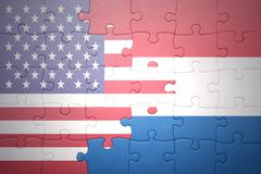 Stock Photo of puzzle with the national flag of united states of america and netherlands