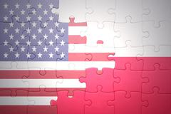 Stock Photo of puzzle with the national flag of united states of america and poland
