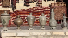 Horizontal panorama(front view) of old samovars, teapots and jugs Stock Footage