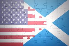 Stock Photo of puzzle with the national flag of united states of america and scotland