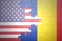 puzzle with the national flag of united states of america and romania - stock photo