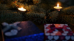 Christmas candles. Christmas and New Year decoration with a lit candle and - stock footage