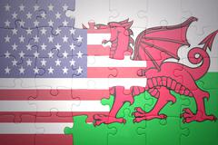 puzzle with the national flag of united states of america and wales - stock photo