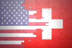 Stock Photo of puzzle with the national flag of united states of america and switzerland