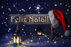 Stock Photo of Sign Candlelight Santa Hat Feliz Natal Means Merry Christmas