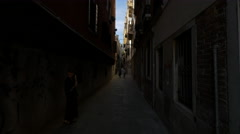 Tourists walking on a narrow street in Venice Stock Footage