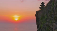 Famous landmark tourist attraction uluwatu temple sunset Stock Footage