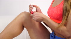 Woman fit girl putting ointment on injury knee 4K Stock Footage