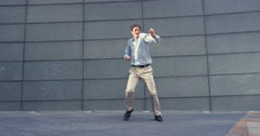 Contemporary funky caucasian businessman street dancer dancing freestyle in the - stock footage
