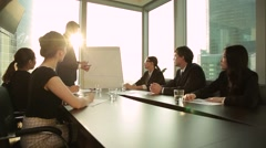 Top manager makes a report to their colleagues. - stock footage