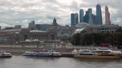 Moskva River with boats, Kievsky Railway Station Square, Moscow-City skyscrapers Stock Footage