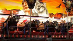 Mechanical bulls at funfair Stock Footage