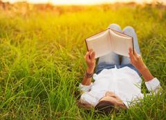 Young Woman Enjoying Book Reading Outdoors Stock Photos
