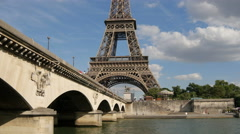 Eiffel tower and Jena bridge on a sunny day in Paris Stock Footage