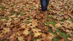 Woman walking on autumn fall grass steadicam 4K. Stock Footage