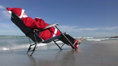 Santa Claus relaxed beach vacation Stock Footage
