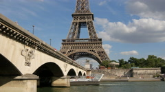Riverboat floating under Jena bridge, near Eiffel Tower in Paris Stock Footage