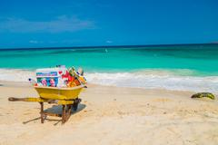 Wheelbarrow belonging to beach vendor in beautiful Playa Blanca or White beach - stock photo