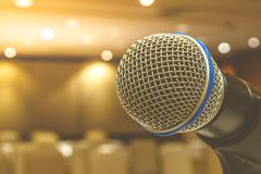 Microphone in meeting room , vintage style - stock photo