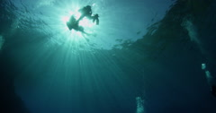 Divers in a sunball Stock Footage