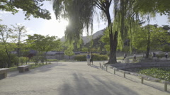 Tourists looking around at Gyungbokgung Palace in South Korea - stock footage