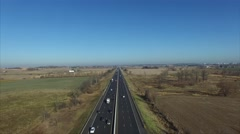 Descending Onto a Highway and Farm Land Descent Stock Footage
