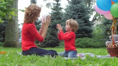 Stock Video Footage of mother playing with her daughter outdoor in nature