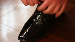 Man tying leather shoe Stock Footage