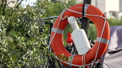 Life buoy hanging on a boat in the Seine riverside, Paris Stock Footage