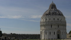 One couple and other tourists walking close to Baptistery of St John in Pisa Stock Footage