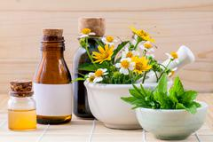 Alternative health care fresh herbal ,honey and wild flower with mortar on wo - stock photo