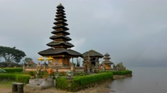 Bali landmark ulun danu bratan temple steady cam cloudy sky Stock Footage